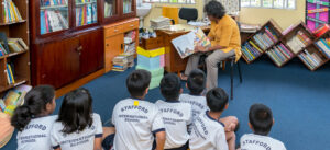 A group of primary school children being taught by the teacher